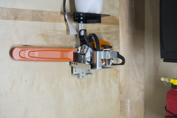 chainsaw bracket and holder for enclosed trailer
