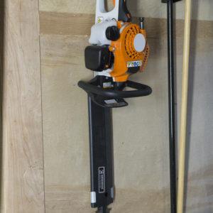 hedge trimmer holder for enclosed trailer