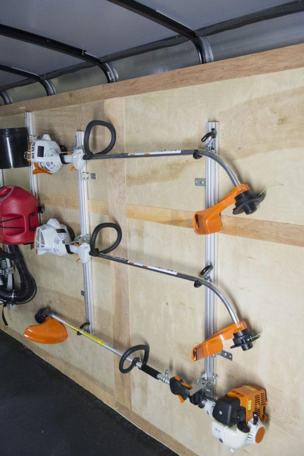 string trimmer holder for enclosed trailer
